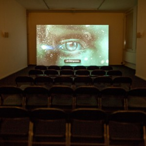 Installation view: Ed Atkins, Warm, Warm, Warm Spring Mouths, 2013. HD video with 5.1 surround sound. Duration 12:50 min. MoMA PS1, New York, 20.01.1301.04.13.