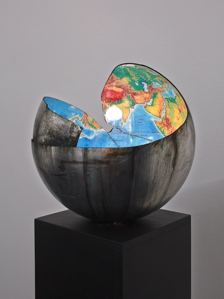 Danny McDonald, <i>Do You Believe In The Future: Part III</i>, 2010-2015, broken silver coated globe, green energy saving bulb, black wooden plinth, 154 x 32 x 32 cm