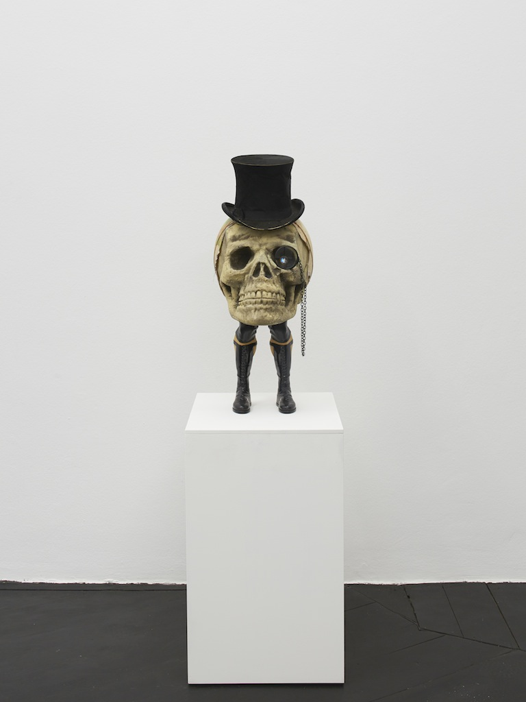 Danny McDonald, <i>The Speculator</i>, 2015, antique top hat, styrofoam skull, wrestler legs, glass monocle, chain, crystal, broken globe, 73 x 40 x 30 cm