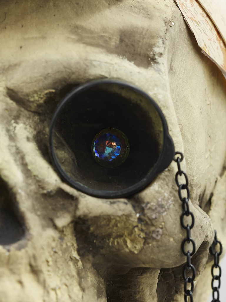 Danny McDonald, <i>The Speculator</i> (detail), 2015, antique top hat, styrofoam skull, wrestler legs, glass monocle, chain, crystal, broken globe, 73 x 40 x 30 cm