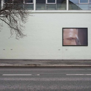 Exterior view of Bergen Kunsthall with print by James Richards James Richards, Crumb Mahogany, Bergen Kunsthall, Norway, February 26 – April 3, 2016