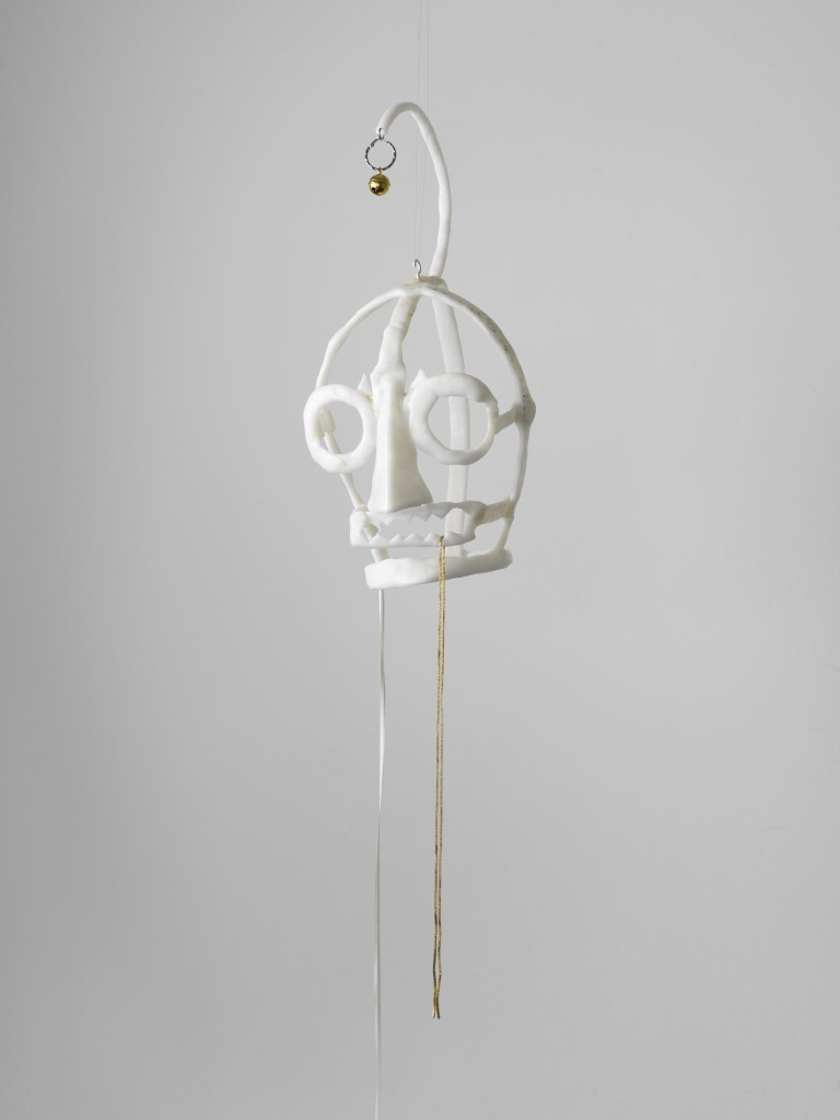 Hannah Black, Shame Mask 2, 2018, Moldable plastic, jewellery, ribbon, bell, metal thread, approx. 46 x 22 x 22 cm, Unique