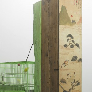 Andrea Branzi, »Grandi Legni GL 17«, 2009. Frame made of ancient beams with hand-made cuts, joints and colourings. Two small cabinets in massive larch reproducing Chinese embroideries and paintings on the doors. Hanging bird cage made of 20 enamelled metal. 240 x 30 x 250 cm. Unique.