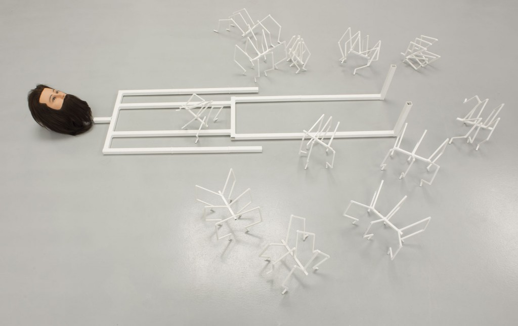 Jos de Gruyter & Harald Thys. »De Droom van Klottemans«. 2013. bearded puppet, metal skeleton, mattress, 12 white metal spiders. variable dimensions. Unique