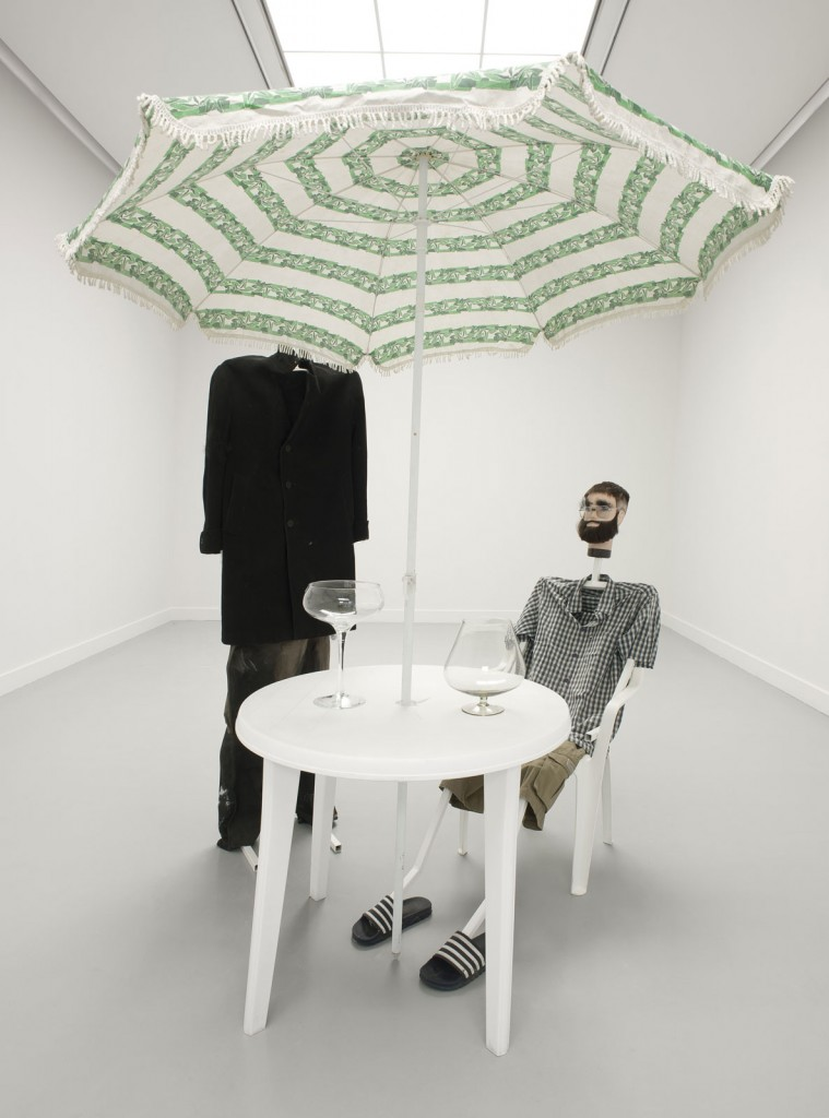 Jos de Gruyter & Harald Thys. »So ist das«. 2013. two puppets with metal skeletons, one polystyrene head, clothing, plastic table and chair, parasol, cognac glasses, relating to the photo series 'Skeletten'. variable dimensions. Unique