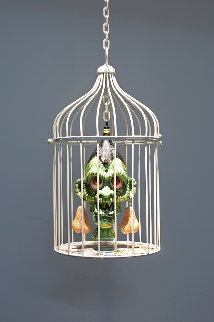 Danny McDonald, <i>Nut Rage</i>, 2015, plastic chain, metal cage, animatronic head, artificial resin testicles, porn, 1.88 cm from floor