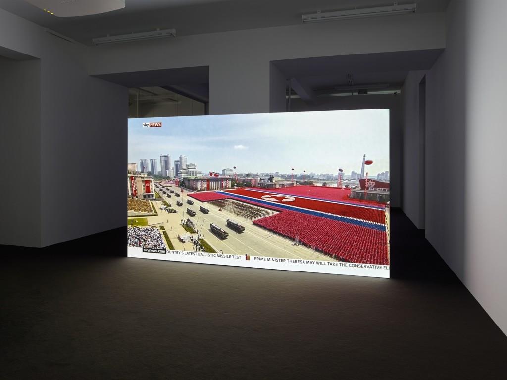 Installation view, Julia Stoschek Collection, Düsseldorf ED ATKINS & SIMON THOMPSON, SKY NEWS LIVE, 2016 TV live stream, colour, no sound, Courtesy of the artists Photo: Simon Vogel