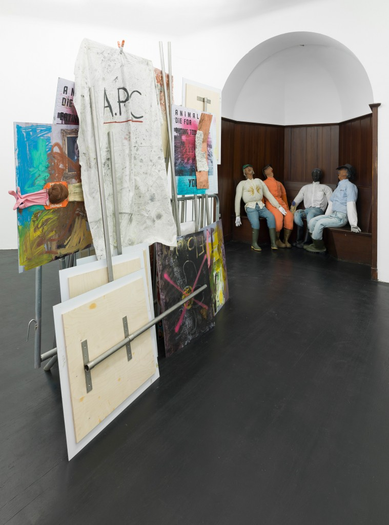 Oscar Murillo, Conditions unknown, part 2, 2014-ongoing, 17 C-type prints mounted on wood, steel poles, four effigies, crowd control barrier and mixed media, dimensions variable